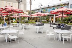 Stiped umbrella tables at Pacific City stock photos