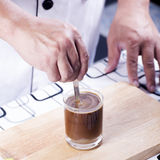 Stir Coffee. Chef putting a spoon in a coffee cup and stir stock image