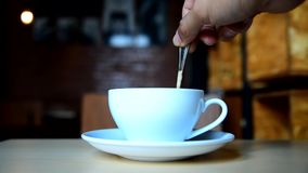 Stir the coffee in cup. And take to drink stock video footage