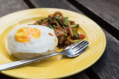 Stir curry rice with fried egg Royalty Free Stock Images