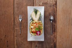 Stir-fired seafood in pineapple ,Ready to eat. On The Table.  royalty free stock images