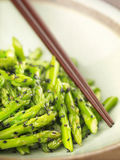 Stir fried asparagus with black sesame. Asian vegetarian stir fried asparagus with black sesame Royalty Free Stock Image