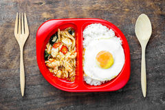 Stir-Fried Basil Chicken and Fried Egg. With Rice royalty free stock photo