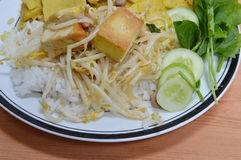 Stir-fried bean sprouts with deep fried tofu and pork chop Royalty Free Stock Images
