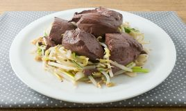 Stir Fried Bean Sprouts with Pork Blood Pudding. Chinese Traditional Food, Stir Fried Bean Sprouts with Pig Blood Curd, Congealed Pork Blood or Pork Blood Stock Photo