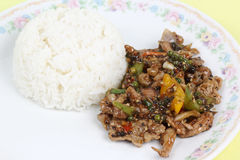 Stir fried beef with black hot pepper and steam rice Stock Photo