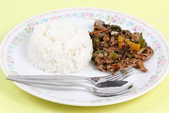 Stir fried beef with black hot pepper and steam rice Royalty Free Stock Photography