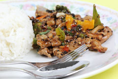 Stir fried beef with black hot pepper and steam rice Stock Image