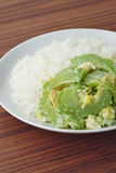 Stir fried bitter gourd with egg on rice Royalty Free Stock Images