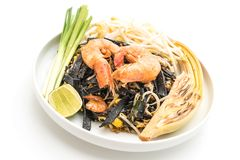 Stir-fried black spaghetti with shrimp (pad thai) - fusion food. Stir-fried black spaghetti with shrimp (pad thai) isolated on white background - fusion food royalty free stock photography