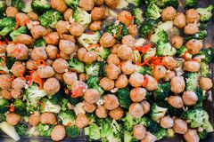 Stir-fried broccoli with shrimp balls. On silver tray stock images