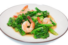 Stir-fried broccoli and shrimp. On dish Royalty Free Stock Photos