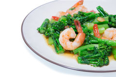 Stir-fried broccoli and shrimp. On dish Royalty Free Stock Photo