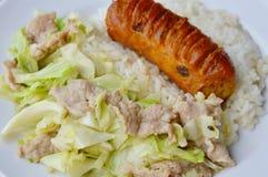 Stir fried cabbage and Thai pork sausage on rice Stock Photo