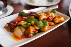 Stir fried chicken with cashew nuts, a famous thai food. At restaurant Royalty Free Stock Images