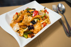 STIR-FRIED CHICKEN WITH CASHEW NUTS. In white dish Royalty Free Stock Photo