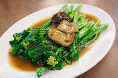 Stir-fried chinese broccoli and shiitake mushroom Stock Photo