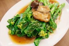 Stir-fried chinese broccoli and shiitake mushroom Stock Images
