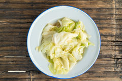 Stir fried chinese cabbage with oyster sauce in white tin dish Stock Photo