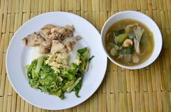 Stir fried Chinese cabbage and salty chicken on rice eat with mixed vegetable soup Stock Images