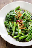 Stir fried chinese kale with oyster sauce Stock Photos