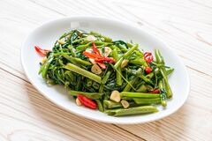 Free Stir-Fried Chinese Morning Glory Or Water Spinach Stock Images - 169453324