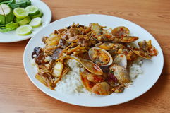 Stir fried clam in curry paste and chicken with slice ginger on rice Stock Photo