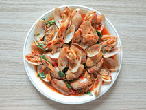 Stir fried clams with roasted chili paste Royalty Free Stock Photos