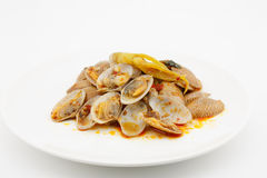 Stir fried clams with roasted chili paste,thai food. On white background Royalty Free Stock Photography