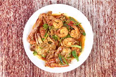 Stir-fried crab and shrimp in curry powder is top-ten of popular Thai food. Stock Image