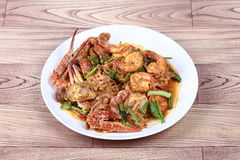 Stir-fried crab and shrimp in curry power is top-ten of popular Thai food as seafood to fried with  fresh milk ,grill curry ,egg , Stock Photo