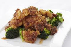 Stir fried crispy fish with broccoli Royalty Free Stock Images