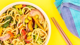 Stir fried egg noodles with fresh vegetables royalty free stock photos