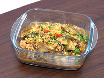 Stir fried Eggplant with pork crushed and salted fish in the clear bowl Stock Photos