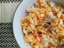 Stir-fry egg. Stir-fried eggs on bamboo mat stock image