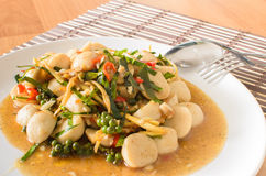 Stir fried fish ball with spicy thai herbs Stock Images