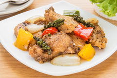 Stir fried fish in black pepper sauce on dish royalty free stock photos