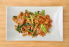 Stir fried flat noodle and pork with dark soy sauce Stock Photos
