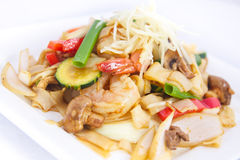 Stir fried flat rice noodles with ginger sauce. royalty free stock photos