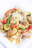 Stir fried flat rice noodles with ginger sauce. Stock Photos