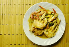 Stir fried flower crab in yellow curry on plate. Stir fried flower crab in yellow curry on white plate Stock Photography