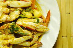 Stir fried flower crab in yellow curry on plate. Stir fried flower crab in yellow curry on white plate Stock Photos