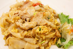 Stir fried fresh noodles with chicken and egg. Stir-fried fresh rice-flour noodles with chicken and egg Stock Images