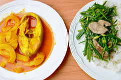 Stir fried garlic chives eat couple with boiled fish spicy and sour soup. Stir fried garlic chives on rice eat couple with boiled fish spicy and sour soup Stock Images