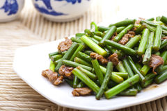 Stir fried garlic scape and shredded pork Royalty Free Stock Photos