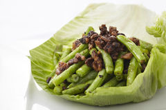 Stir-fried green bean with minced pork and Chinese black olives Royalty Free Stock Photo