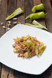 Stir Fried Green Chili with pork. On white plate Royalty Free Stock Photo
