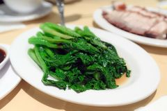Stir fried green vegetable on white plate Royalty Free Stock Photo