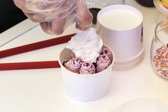 Stir-fried ice cream rolls at freeze pan. Rolled ice cream, hand made ice cream dessert. Stir-fried ice-cream from milk and berry. Jam. Fried machine with steel stock photos