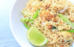 Stir fried instant noodle. With egg and pork Stock Photos